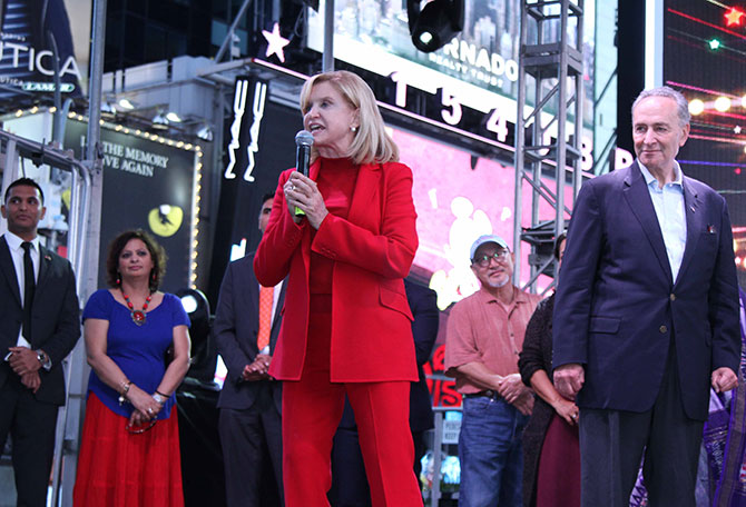 US Congresswoman Carolyn B Maloney, who co-helmed the successful Diwali Stamp project with Ranju Batra, addresses the crowds, as her fellow Democrat, US Senator Chuck Schumer looks on. Diwali@Times Square