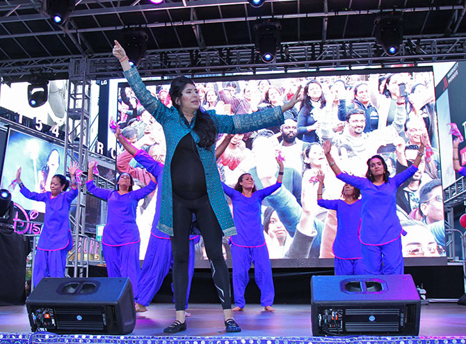 Masala Bhangra's Sarina Jain, who is 34 weeks pregnant, teaches the crowd at Diwali@Times Square some moves.