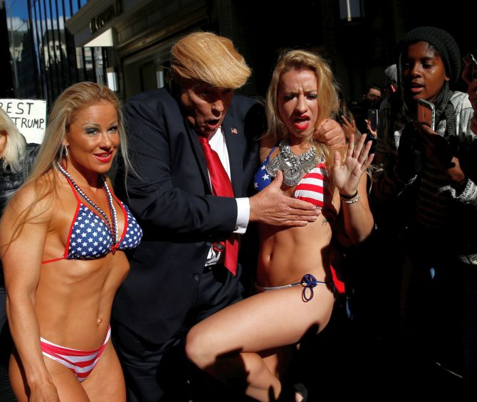 India News - Latest World & Political News - Current News Headlines in India - PHOTOS: 'Trump' takes Times Square with a band of bikini-clad babes