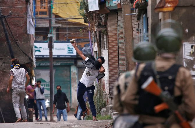 Kashmiri youth pelt stones at the security forces in Srinagar in September 2016.