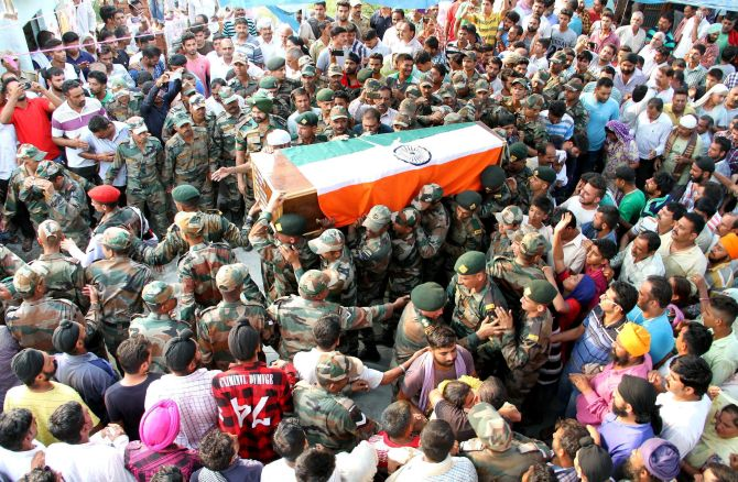 India News - Latest World & Political News - Current News Headlines in India - PHOTOS: Nation bids tearful adieu to its fallen heroes
