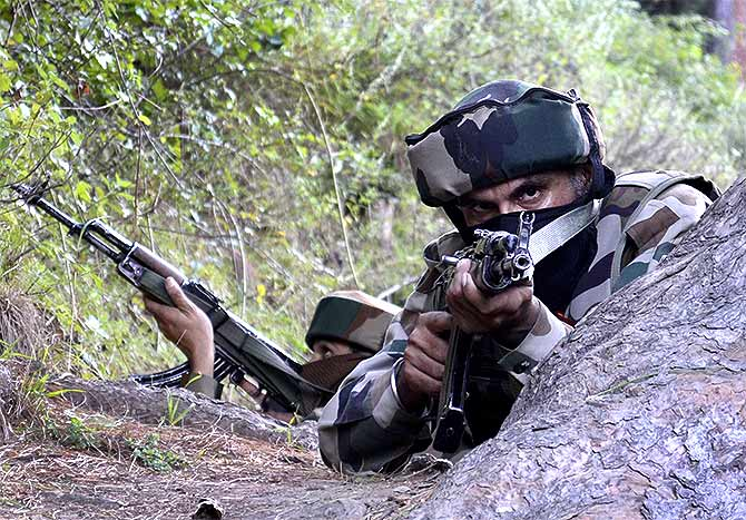 Soldiers search for terrorists in Lachipora in Uri. Photograph: Umar Ganie