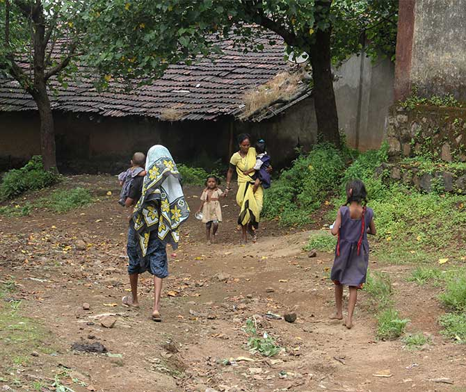 Not all children come regularly to the Pimpalwadi anganwadi. Smita Wagh, in yellow, an assistant to Lahubhuge, then goes home hopping and brings these children in her tow to the anganwadi.