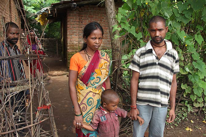 Namdev with his son Krushna, 4.5 years, and his wife Sunder outside their home in Khoch, Mokhada. His eldest daughter Sonali had been to a primary school nearby.