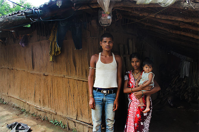 The Waghs outside their house at Kalamwadi, a small tribal hamlet, with around 30-odd houses. Unlike, Petranjani, Kalamwadi residents are beneficiaries of metered electricity.