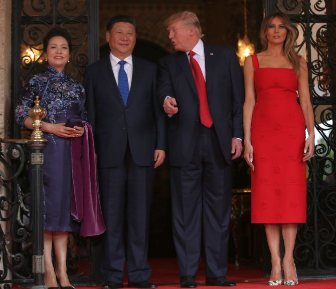 Chinese President Xi Jinping and his wife Peng Liyuan with US President Donald Trump and his wife Melania Trump at the start of their summit in West Palm Beach, Florida. Photograph: Carlos Barria/Reuters