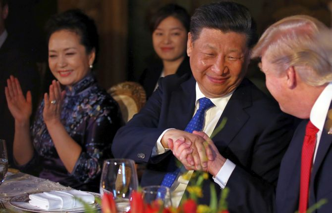 Chinese President Xi Jinping, his wife Peng Liyuan with US President Donald Trump at the dinner during their summit at Trump's Mar-a-Lago estate in West Palm Beach, Florida. Photograph: Carlos Barria/Reuters