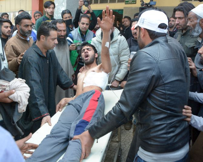 A youth injured in the April 9 violence shouts slogans as he is taken to hospital in Srinagar. Photographs: Umar Ganie