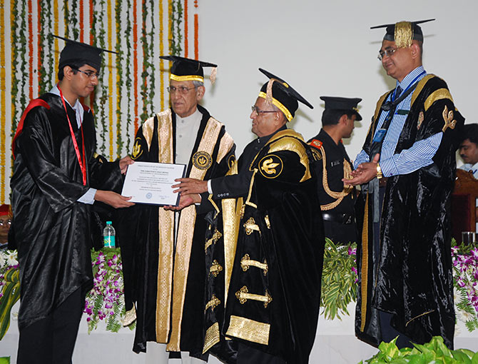 President Pranab Mukherjee, the chief guest, at IIT-Kanpur's 45th convocation presents a degree to an IIT topper, July 5, 2013. Image only published for representational purposes. Photograph: Kind courtesy IIT-Kanpur