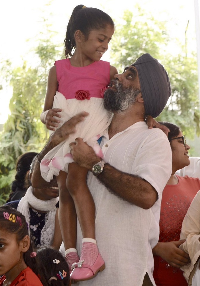 India News - Latest World & Political News - Current News Headlines in India - Canada's first Sikh defence minister returns to India