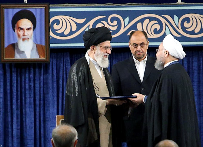 Iranian President Hassan Rouhani receives the presidential mandate from Iran's Supreme Leader Ayatollah Ali Khamenei at an endorsement ceremony, Tehran, August 3, 2017. Photograph: President.ir/Handout/Reuters