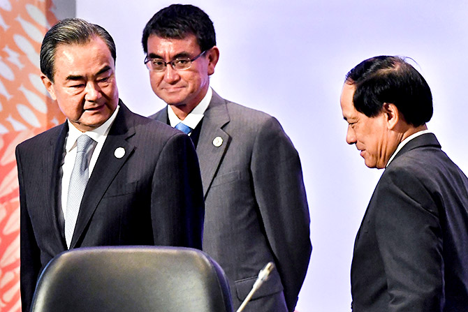 China's Foreign Minister Wang Yi, left, with Japan's Foreign Minister Taro Kono and ASEAN Secretary General Le Luong Minh before the 18th ASEAN Plus Three Foreign Ministers Meeting, part of the 50th Association of ASEAN Regional Forum meeting in Manila, Philippines, August 7, 2017. Photograph: Mohd Rasfan/Pool/Reuters