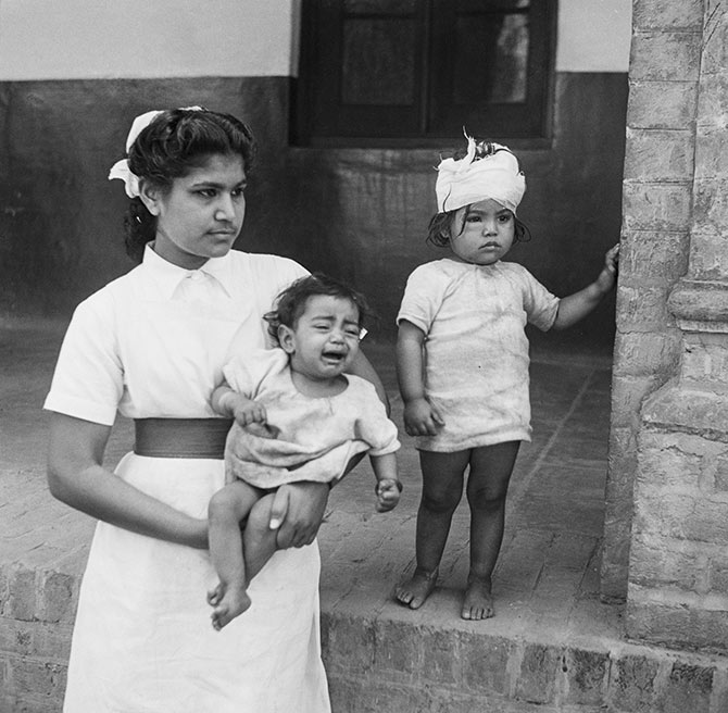 A nurse with two child victims of communal violence in Amritsar, Punjab, during the Partition of British India, March 194