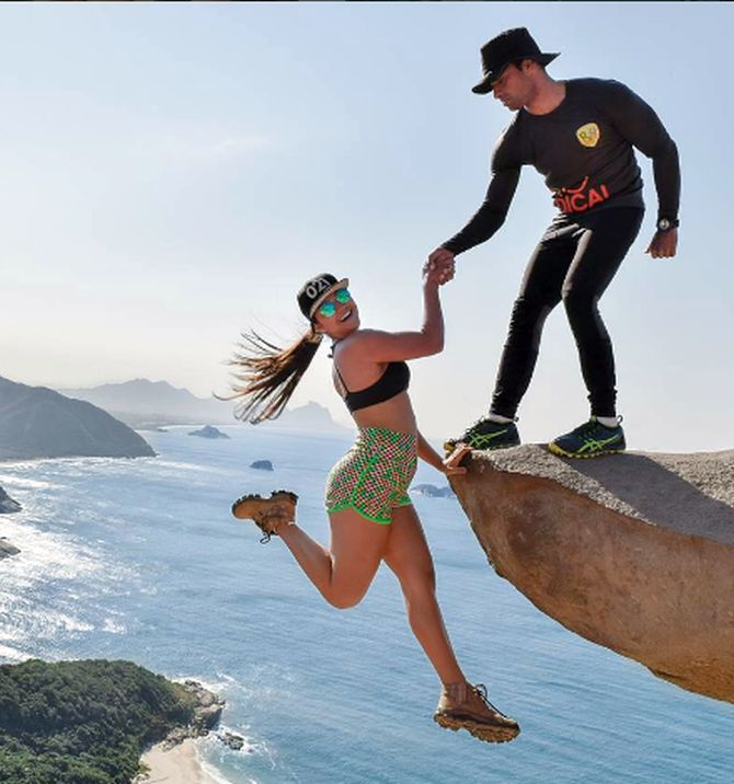 India News - Latest World & Political News - Current News Headlines in India - Daredevil dangling his fiance over cliff isn't quite what it seems