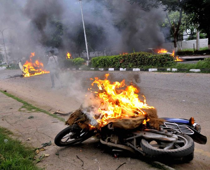 Vehicles burn in the violence in Panchkula, August 25, 2017. Photograph: PTI Photo