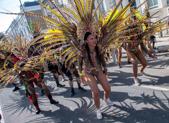 India News - Latest World & Political News - Current News Headlines in India - PHOTOS: It's feathers and a whole lot of fun at Notting Hill carnival