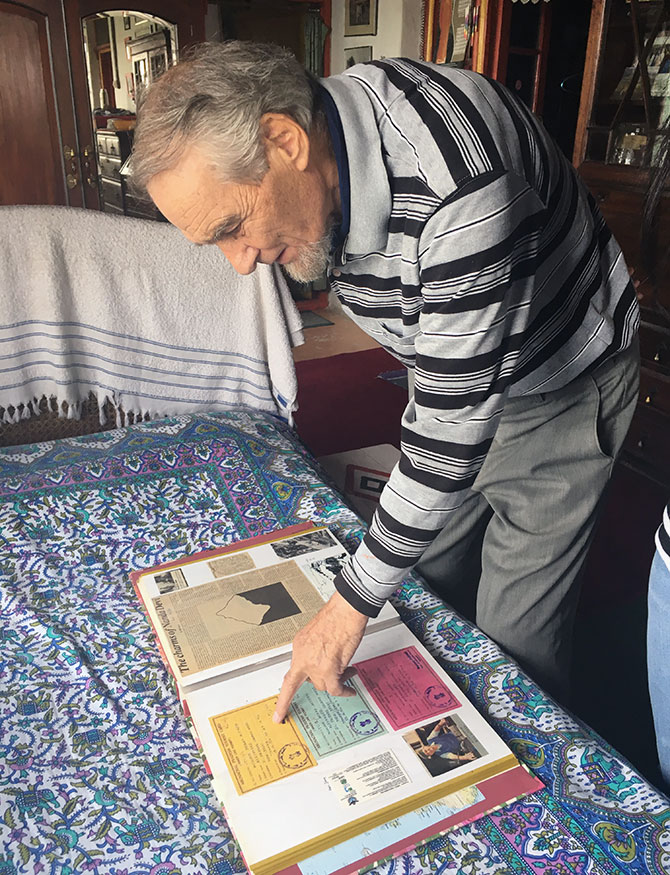 Bill Aitken shows his scrapbook of journeys