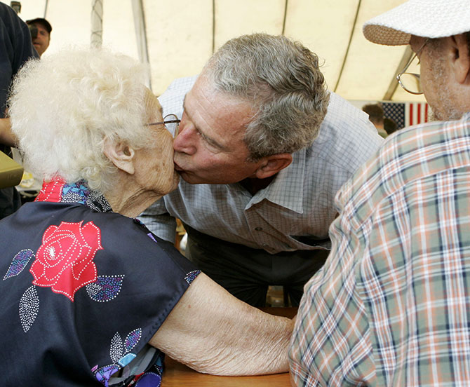 George W Bush kisses Helen Dedeaux, 94, while visiting Hurricane Katrina's victims in Gulfport, Mississippi, September 12, 2005.
