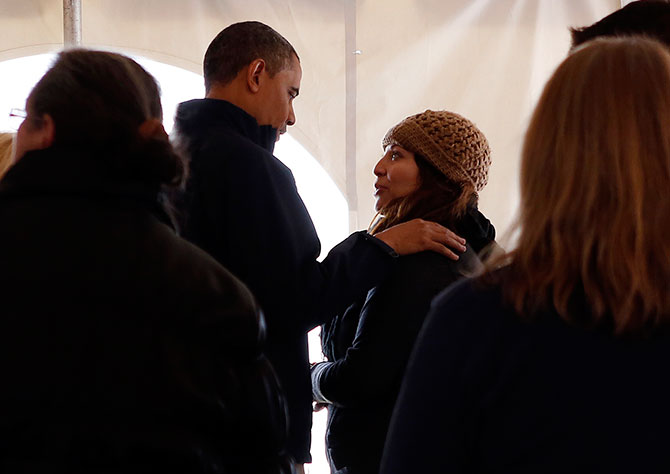 Barack Obama meets with residents affected by Hurricane Sandy at a Staten Island disaster recovery centre in New York, November 15, 2012.