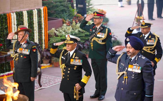 Navy chief Admiral Sunil Lanba, centre, flanked by army chief General Bipin Rawat, left, and air force chief Air Chief Marshal Birender Singh Dhanoa at the Amar Jawan Jyoti on Navy Day, December 4, 2017. Photograph: SpokespersonMoD/Twitter