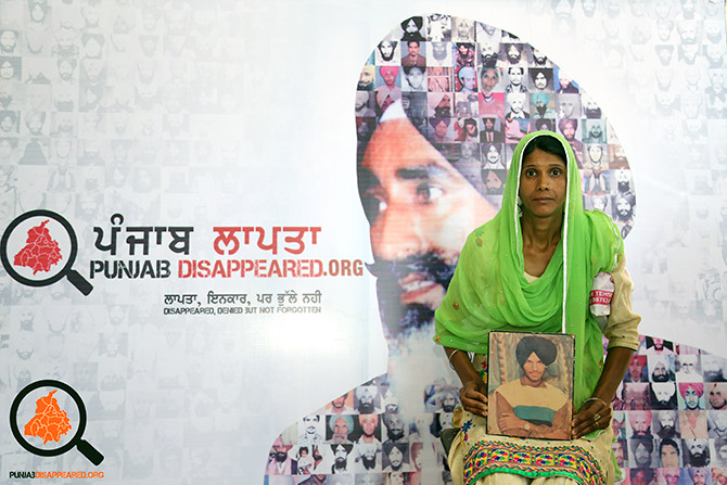 A family member with a photograph of a person who went missing in Punjab during the troubled years. Photograph: Kind courtesy Punjab Disappeared.org