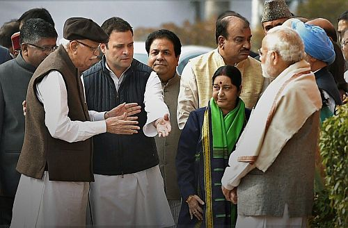 Rahul Gandhi escorts Lal Kishenchand Advani as Prime Minister Narendra D Modi looks on, Parliament House, December 13, 2017.