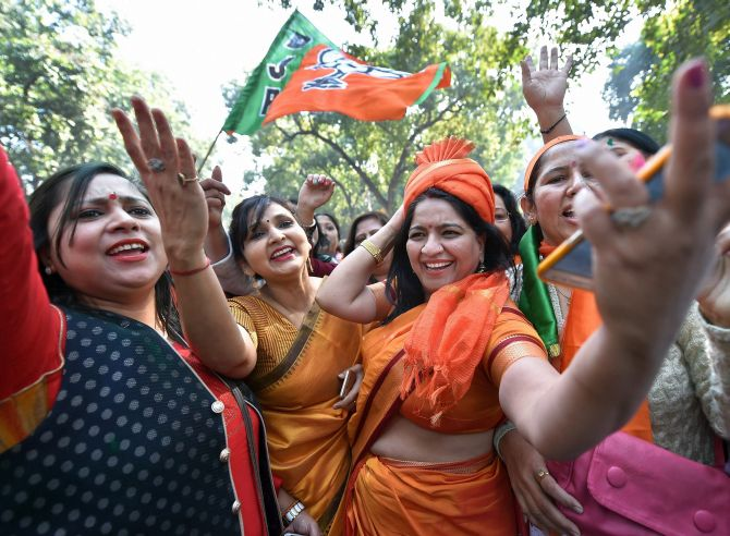 BJP supporters celebrate outside the party headquarters in New Delhi. Photograph: Arun Sharma/PTI Photo