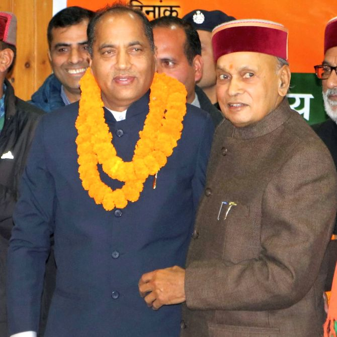 Prem Kumar Dhumal, right, congratulates Jairam Thakur who was chosen over him as Himachal Pradesh chief minister. Photograph: PTI Photo