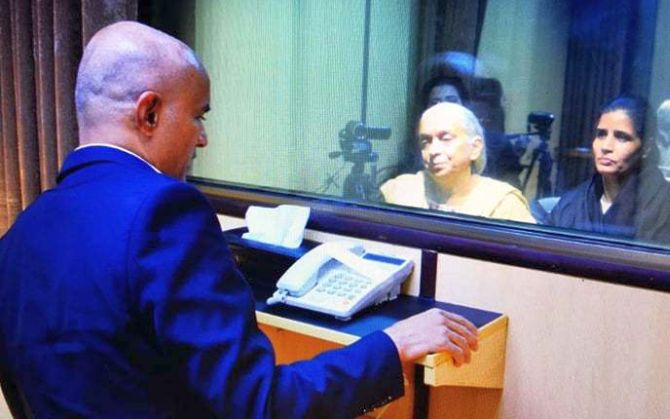 Kulbhushan Jadhav meets his mother Avanti and wife Chetna at Pakistan's foreign ministry in Islamabad. Photograph: Pakistan foreign office
