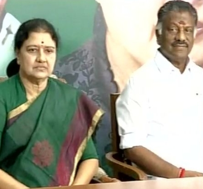 Tamil Nadu interim Chief Minister O Panneerselvam, right, with Sasikala Natarajan