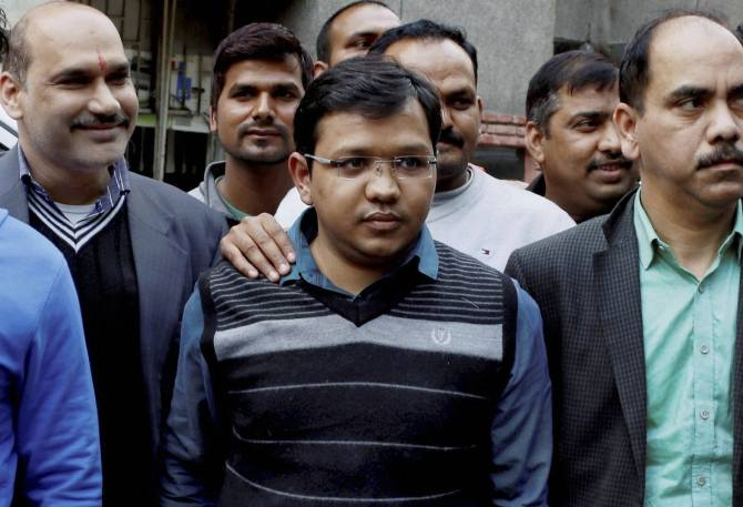 Anubhav Mittal, centre, known for his flashy lifestyle, was arrested by the UP STF, as the kingpin of the Rs 3,700 crore online ponzi scam