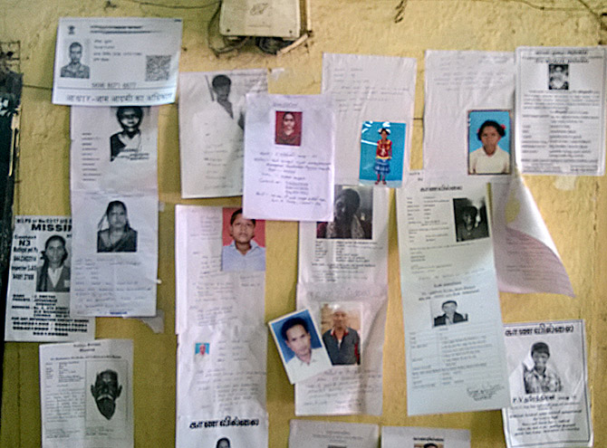 Photos of missing persons at the railways police station in Chennai