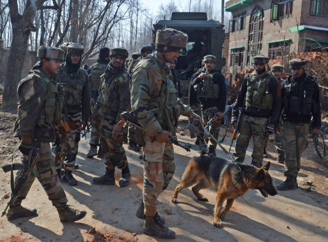 Soldiers conduct search operations, February 12, 2017, after four terrorists, two army personnel and a civilian were killed in a fierce gunfight in a village in south Kashmir. Photographs: Umar Ganie