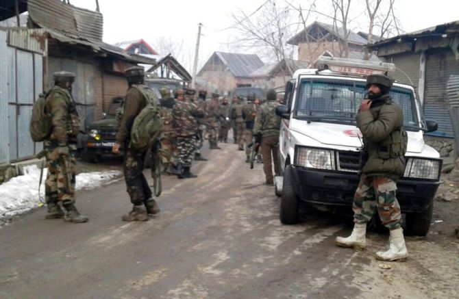 Soldiers at the venue of an encounter in Kralgund, Kupwara, north Kashmir, February 14, 2017. Four soldiers including a major were killed in the firefight in which four terrorists died. Photograph: Umar Ganie