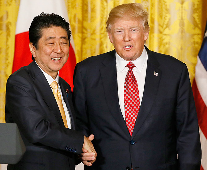US President Donald Trump, right, with Japanese Prime Minister Shinzo Abe