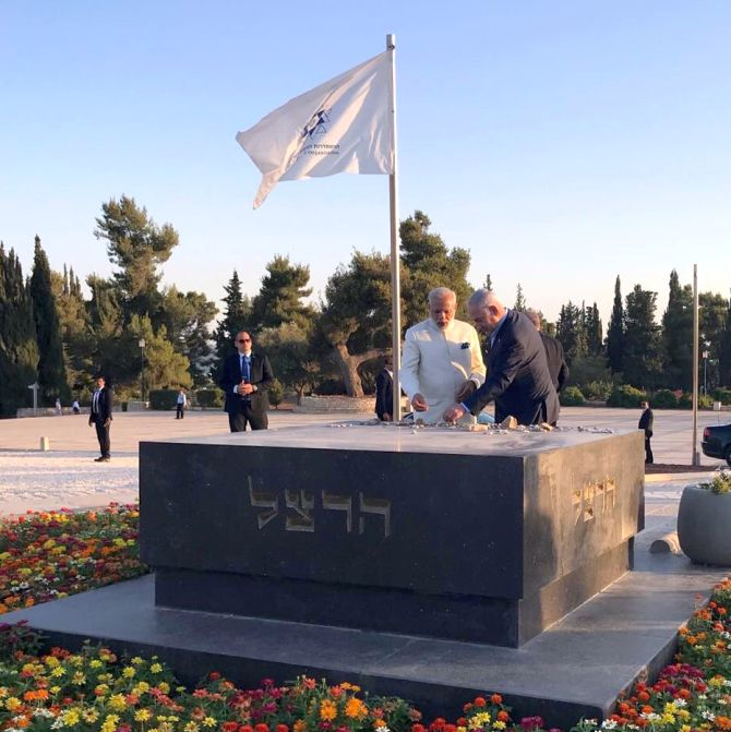Prime Minister Narendra Modi and Israel's Prime Minister Benjamin Netanyahu at the grave of Theodor Herzl, considered the father of the State of Israel, June 4, 2017. Photograph: @netanyahu/Twitter