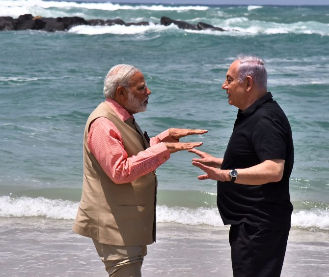 Prime Minister Narendra Modi and Israel Prime Minister Benjamin Netanyahu on an Israeli beach, July 6, 2017.