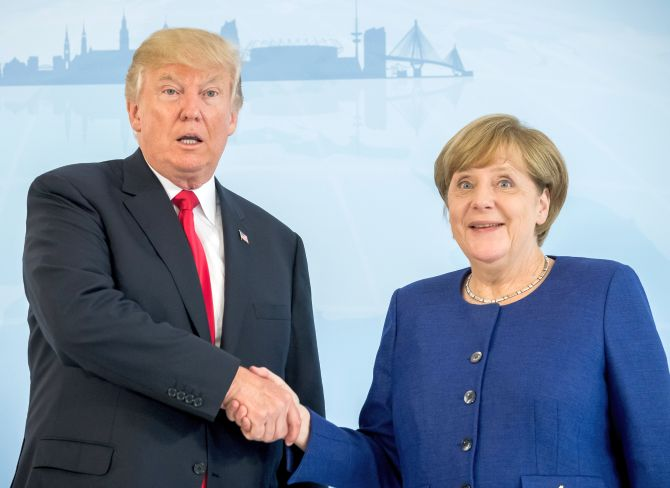 US President Donald J Trump with German Chancellor Angela Merkel at the G20 Summit in Hamburg, July 6, 2017. Photograph: Matthias Schrader/Pool/Reuters