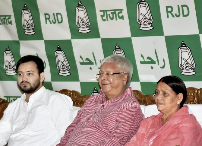 Former Bihar chief ministers Lalu Prasad Yadav, centre, and  Rabri Devi, right, with their son Bihar Deputy Chief Minister Tejashwi Yadav. Photograph: PTI photo