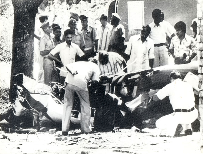 Investigators examine the wreckage of Sanjay Gandhi's Pitts S-2A plane. He had taken it for a joyride and lost control while doing aerobatics. Sanjay lost his life in the ensuing crash.