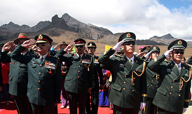 Indian and Chinese soldiers mark the 60th anniversary of the founding of the People's Republic of China at the India-China border in Arunachal