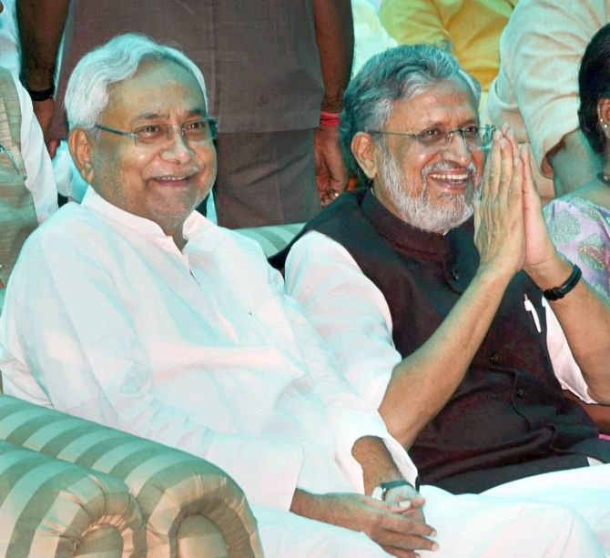 Bihar Chief Minister Ntish Kumar and Deputy Chief Minister Sushil Kumar Modi after they were sworn in on July 27, 2017. Photograph: PTI Photo