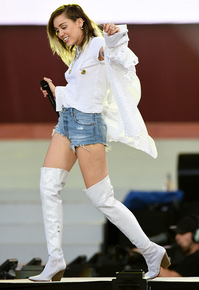 NO SALES, free for editorial use. In this handout provided by 'One Love Manchester' benefit concert Miley Cyrus performs on stage on June 4, 2017 in Manchester, England. Donate at www.redcross.org.uk/love  (Photo by Getty Images/Dave Hogan for One Love Manchester)'