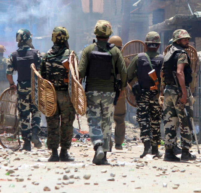 Soldiers have to deal with terrorists as well as stone pelters at encounter sites, this one on June 16, 2017 in Kashmir. Photograph: Umar Ganie