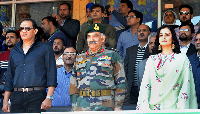 Former India captain Mohammad Azharuddin and actress Dia Mirza at an army event in Kashmir