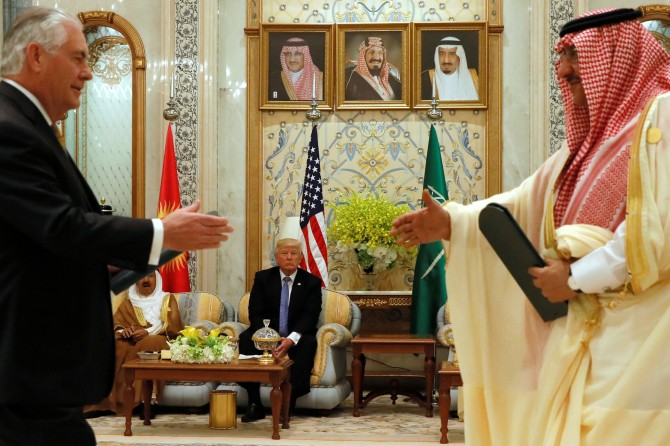 US President Donald Trump, centre, looks on as US Secretary of State Rex Tillerson, left, formerly Exxon's CEO, and Saudi Arabia's then crown prince Muhammad bin Nayef, right exchange a memorandum of understanding, a commitment by the Gulf states not to finance terrorist organisations, at the Gulf Cooperation Council leaders summit in Riyadh, Saudi Arabia, May 21, 2017. Photograph: Jonathan Ernst/Reuters
