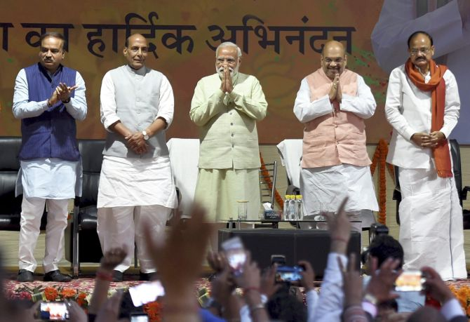 Narendra Modi with BJP President Amit Shah, Union Ministers Ananth Kumar, Rajnath Singh and M Venkaiah Naidu at the party headquarters, March 12, 2017. Photograph: Kamal Singh/PTI Photo