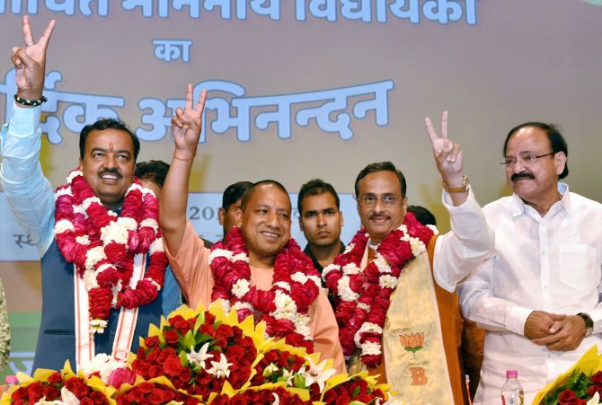 Yogi Adityanath, centre, Keshav Prasad Maurya, left, and Dr Dinesh Sharma. Union Minister M Venkaiah Naidu is also seen. Photograph: Nand Kumar/PTI Photo