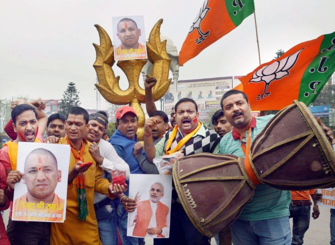 Yogi Adityanath's supporters celebrate his appointment as CM