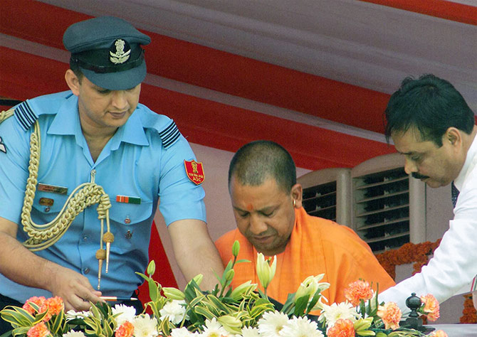 Squadron Leader Praveen Bhoria of the Indian Air Force, the aide-de-camp to Uttar Pradesh Governor Ram Naik, left, assists Chief Minister Yogi Adityanath after the swearing-in ceremony. Photograph: Sandeep Pal